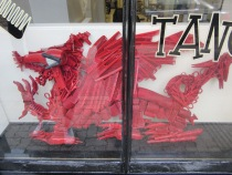 A dragon at the hairdressers made of hair things!
