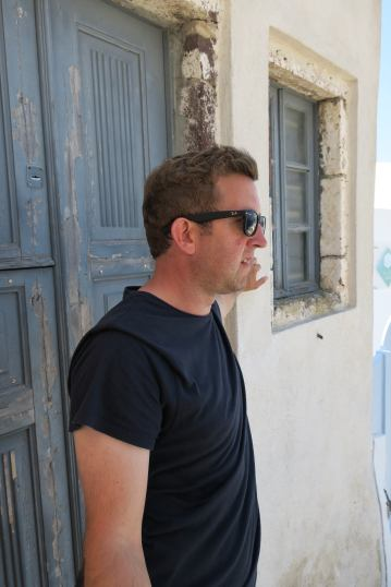 Neil looking cool in a door way in Oia