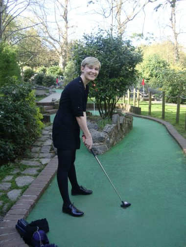 Sarah playing crazy golf - just before an epic hole in one